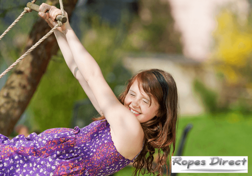 child playing rope game in garden