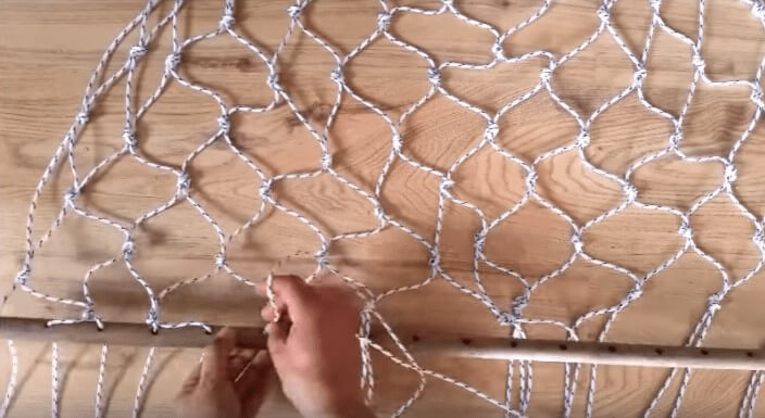 adding the second dowel to the rope hammock